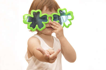 little girl, wearing funny, clover shaped, sunglasses, isolated on white Stock Photo - 956452
