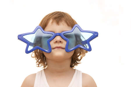 little girl, wearing funny, star shaped, sunglasses, isolated on white