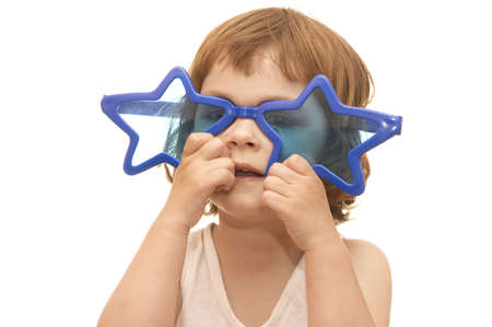 little girl, wearing funny, star shaped, sunglasses, isolated on white Stock Photo - 956457