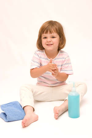 little, cute girl washing her hands with a blue soap Stock Photo - 1342592