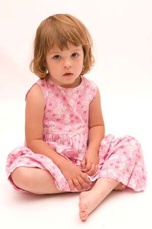 little, cute girl wearing pink dress on white background photo
