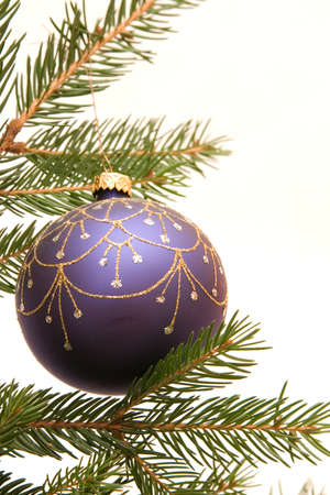 blue Christmas bulb on conifer, cornered, with copy space photo