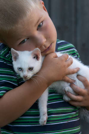 portrait of a boy with his cat