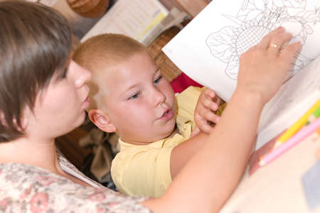 boy doing his homework with mother's help Stock Photo - 1629991