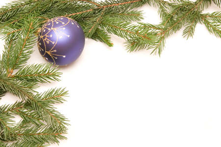 Christmas frame - conifer with blue bulbs isolated on white photo