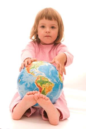 bare girl: little girl holding globe isolated on white Stock Photo