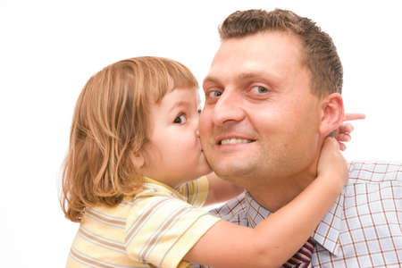 little girl kissing her father after he came back from work photo