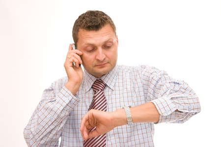 businessman talking on the phone and checking time