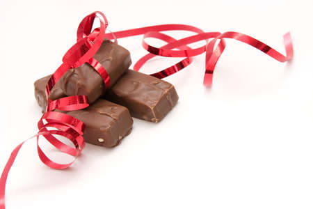 composition made of little chocolate bars and ribbons photo