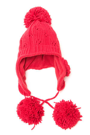 pom: red winter cap with pom poms isolated on white