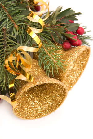 Christmas wreath with ribbons, golden bells and hawthorn photo