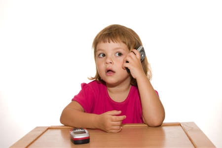 little cute girl talking on mobile phone, isolated on white