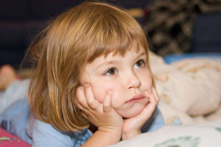 poorly: little, cute girl lying in bed and looking poorly