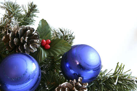 Blue Christmas balls decorated with spruce, cones and mistletoe Stock Photo
