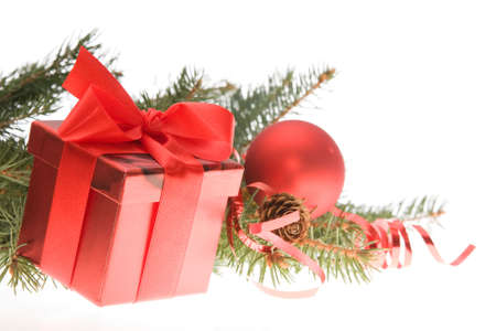 red gift box with bow and Christmas tree twig Stock Photo