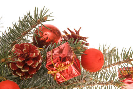 Christmas decoration made of little gifts and conifer, isolated on white