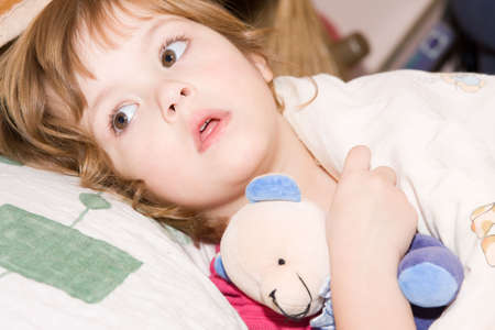 little cute girl with cuddly toy falling asleep Stock Photo - 2123424