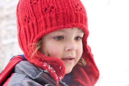 freezing: little girl - portrait in winter, snowy scenery Stock Photo