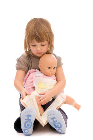 story time - little girl reading a book to her doll