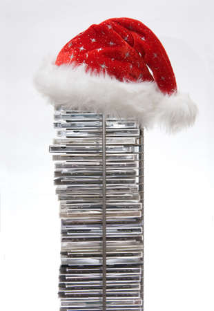 Santa Claus hat on compact disc stand isolated on white background  Stock Photo