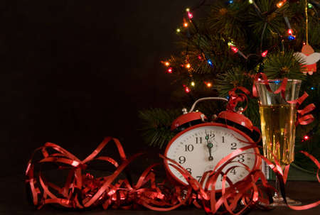 red clock and glass of champagne on Christmas background photo