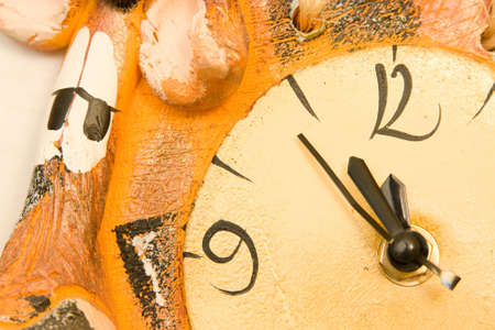 just in time: clock showing time just before midnight, close up Stock Photo
