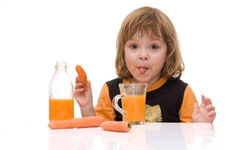 little, cute girl tasting carrot juice isolated on white