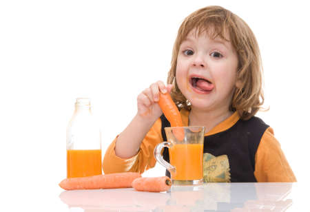 little, cute girl tasting carrot juice isolated on white
