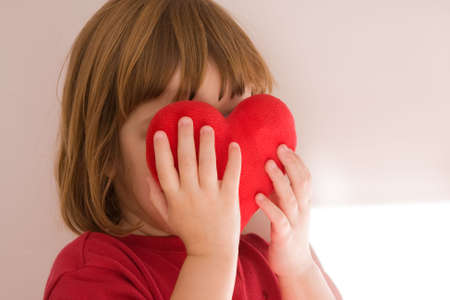love is blind, girl covering face with heart