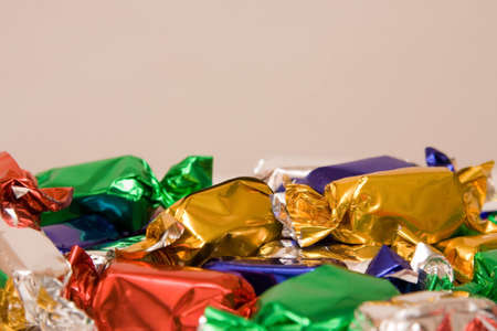 cope: chocolates in colorful wrappings with cope space Stock Photo