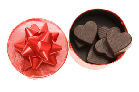 indulging: little red gift box full of heart shaped chocolates Stock Photo