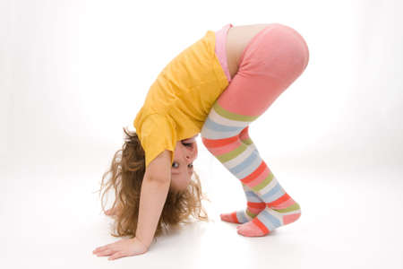little, cute girl exercising isolated on white Stock Photo