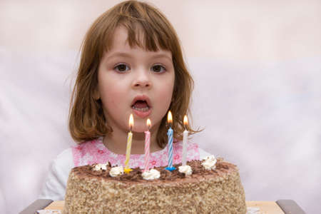 tort: little cute girl celebrating her fourth birthday