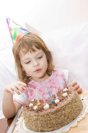 little cute girl celebrating her fourth birthday Stock Photo - 2587406