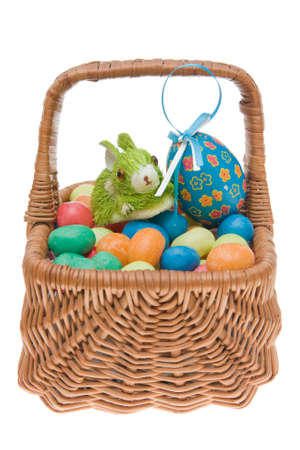 Easter sweets in a wicker basket and bunny, isolated on white Stock Photo - 2606810