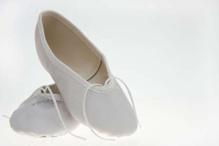 ballet slippers: white childs ballet slippers isolated on white background Stock Photo