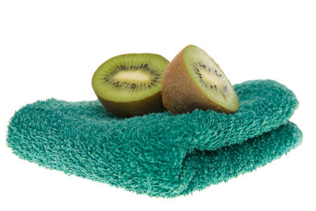 handwash: liquid soap, fruits and green towel isolated on white