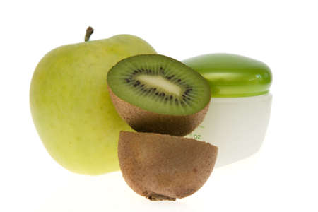 kiwis: composition of fruits and face cream jar isolated on white