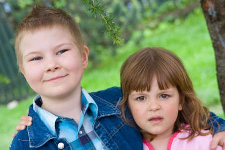 litle: litle boy and pretty girl, portrait outdoors Stock Photo