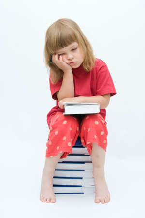 little, tired girl with books on white background