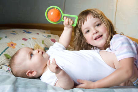 little brother and sister playing together, on white Stock Photo - 3415755