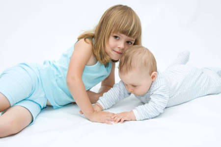 little brother and sister playing together, on white Stock Photo - 3427302