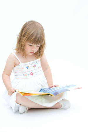 skillful: little girl reading fairy tales on white background