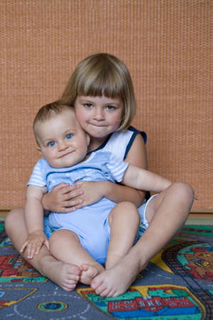 little baby boy and his sister, together in their room Stock Photo - 3502020
