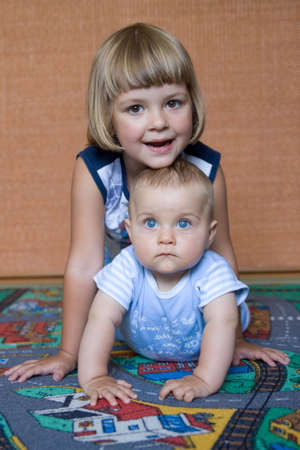 little baby boy and his sister, together in their room Stock Photo - 3502019