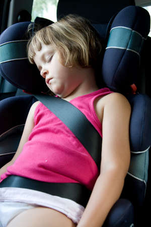 little girl sleeping in safety car seat