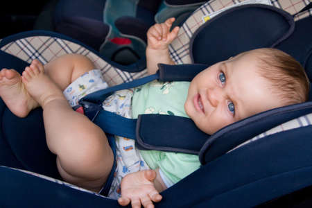 car seat: little baby sitting in safety car seat