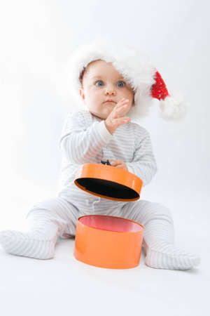 little, cute baby boy wearing Christmas hat, on white Stock Photo - 3551163