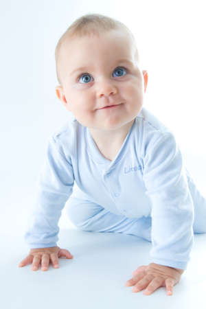 crawling baby boy on bright background