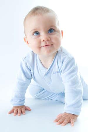crawling baby boy on bright background